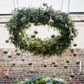 Beautiful Blooms Jordan_Brian_Photography_Vie Outside Ceremony Hanging Candle Wreath