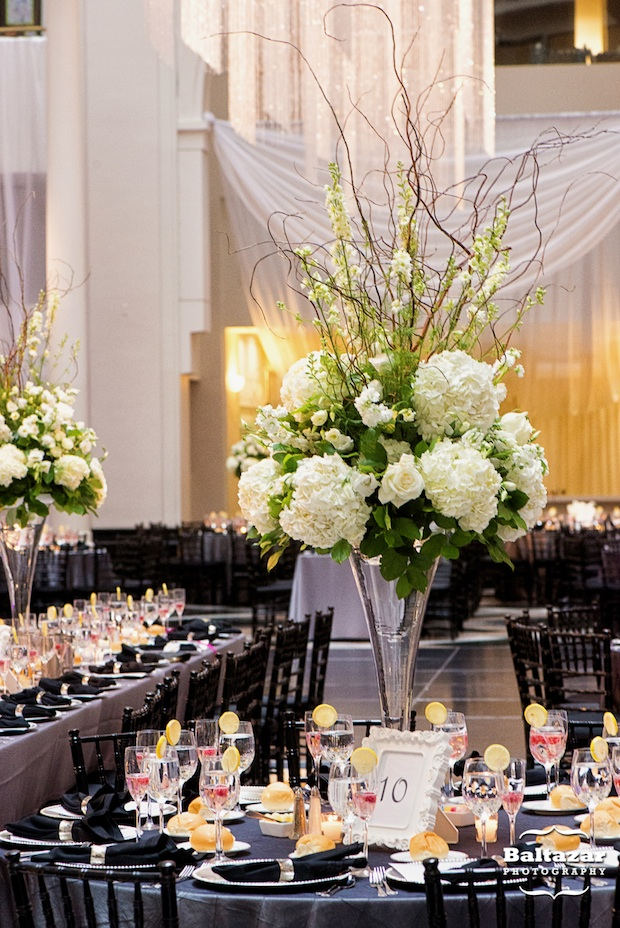 Friday feature tall white and ivory floral centerpieces