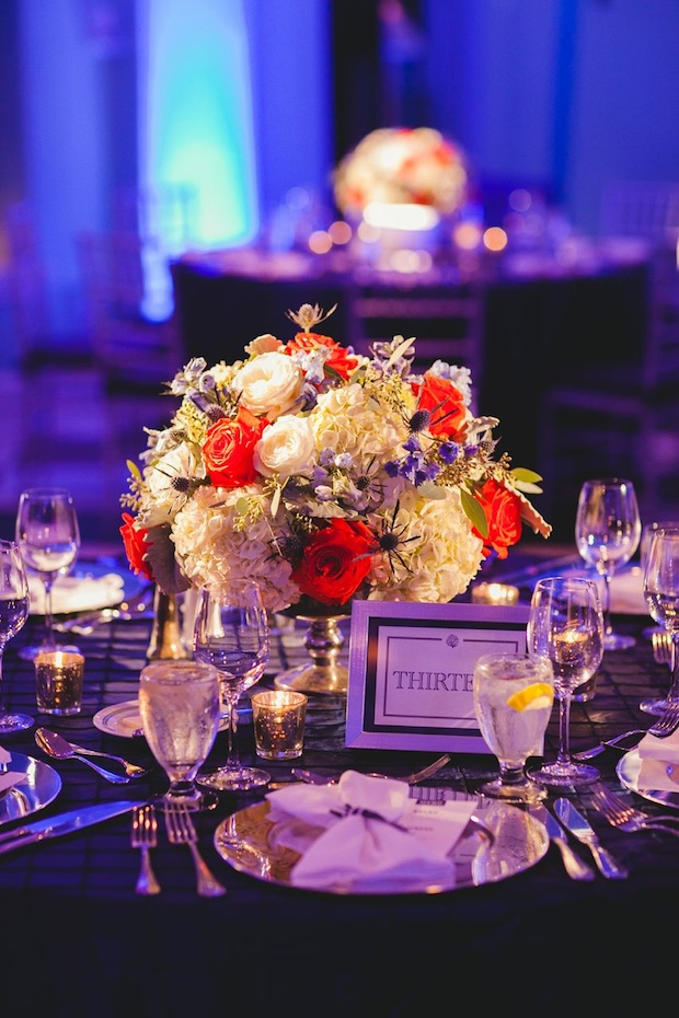 Beautiful Blooms 217 Photography Cape May Wedding Congress Hall Ceremony and Reception Low Centerpiece Silver Compote Bowl Silver Mercury Votives Silver Charger Plates Custom Table Number Thistle Roses Hydrangea Delphinium Orange