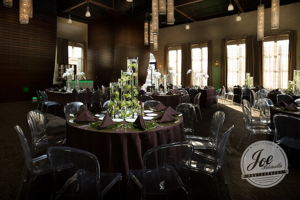 Beautiful Blooms Joe Pulcinella Phoenixville Foundry Lucite Chairs Spun Wire Brown Linens Green Charger Plates Submerged Green Cymbidium Orchids Floating Candles