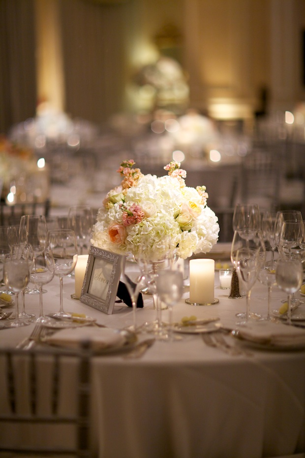 Beautiful Blooms Sarah DiCicco Philadelphia Country Club Wedding Peach and Ivory low centerpieces candles Roses Hydrangea Stock