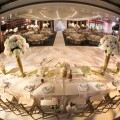 Beautiful Blooms MK Photography Saigon Maxim Reception Crystals Tall Centerpieces Gold Vases Gold Votives Hydrangea Roses White Dance Floor Gold Chairs Champagne Babies Breath