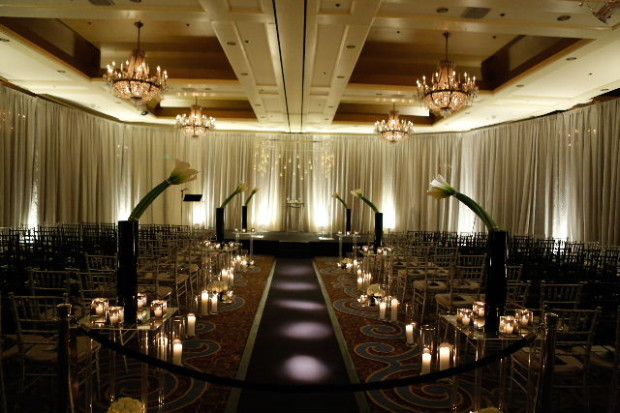 Beautiful Blooms Duca Photography The Four Seasons Same Sex Wedding Monogram Art Deco Wedding Lucite Chuppah Ceremony Hanging Candles Calla Lilies Black Aisle Runner