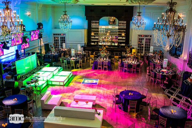 Beautiful Blooms Anne Marie Casey PHotography Bar Mitzvah Syracuse Blue and Orange Logo Dance Floor Sports Orange Flowers Lampshades Lounge