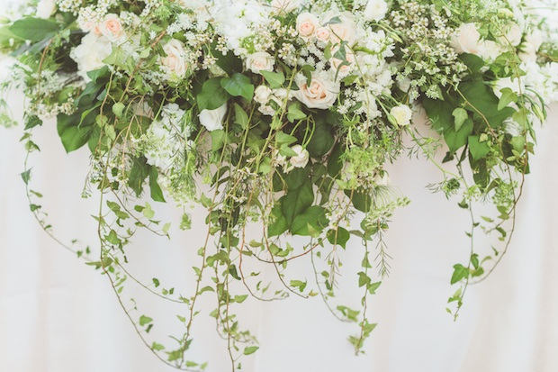 Beautiful Blooms Styled Creative Paper Antler Photography Saucon Valley Country Club Sweetheart Table Dripping Florals White and Green Ivy Roses Wax Flower Spray Roses Arrangement