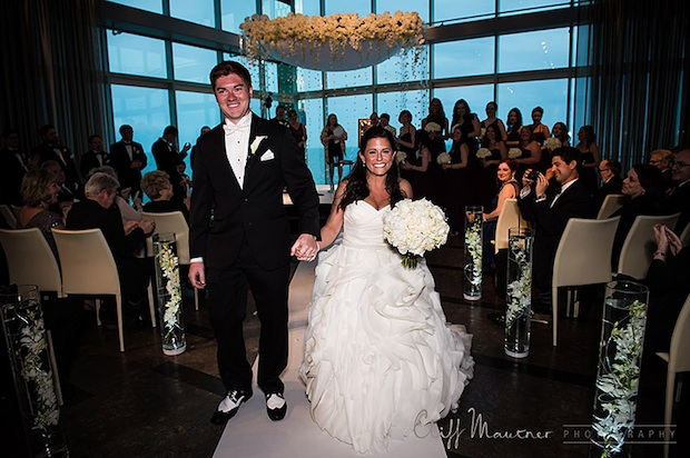 Beautiful Blooms One Atlantic Cliff Mautner Photography Chuppah Beach Wedding Atlantic City White Flowers Submerged Flowers Light Up Orchid Garlands