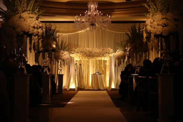 Beautiful Blooms MaxStudio & Art Studio Uplighting Chuppah Wedding Ceremony White and Ivory Flowers Fabric and Floral Chuppah Tall Centerpieces Orchid Garlands The Westin Philadelphia