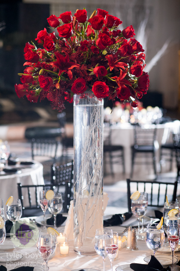 Beautiful Blooms Tyler Boye Tall Red Centerpiece White Branches Roses The Curtis Center Reception Candles