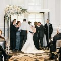 Beautiful Blooms Emily Wren Photography Chuppah Le Meredien Wedding Ceremony Tallits Asymmetrical Flowers White Peach Greenery Peonies Stock Snapdragons Hydrangea Wrought Iron White Topper