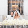 Beautiful Blooms The Down Town Club Crystal Backdrop Sweetheart Table Mirrors Candles Crystals Long low arrangement Hydrangea floating candles Bride and Groom The Down Town Club