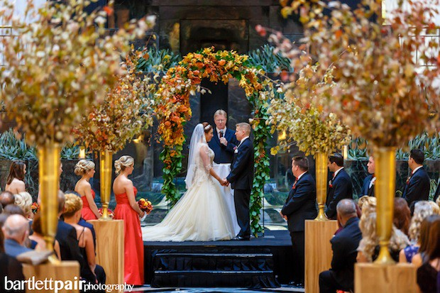 Beautiful Blooms BartlettPair Curtis Center Fall Wedding Arch Pedestals Maple Leaf Branches Berries