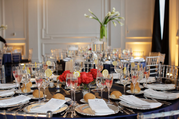 Beautiful Blooms Joe Pulcinella Photography The Down Town Club Low Centerpiece Floating Candles Orange Flowers Candles