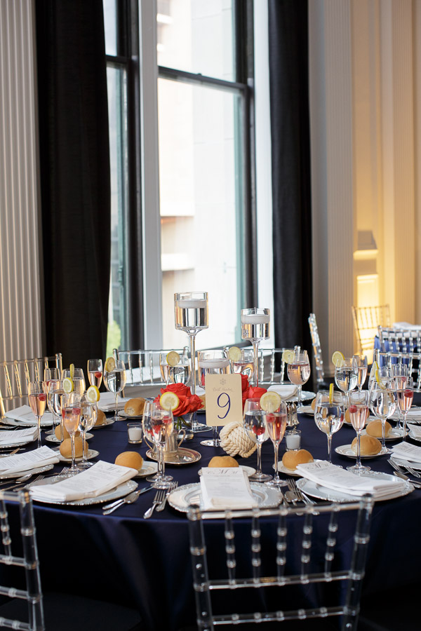 Beautiful Blooms Joe Pulcinella Photography The Down Town Club Nautical Low Centerpiece Floating Candles Orange Roses