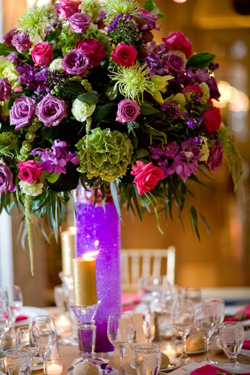 The dinner table centerpieces were large arrangements of fuschia