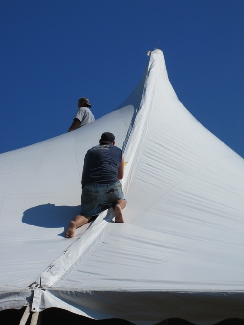 This was wild to watch as two of the tent guys crawled up the side of